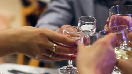 cheers : Male and female hands clink wineglasses after toast. Closeup Stock Footage
