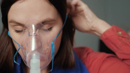 compressor : Girl remove mask for inhalation from her face and turns off nebulizer. Slow motion and close-up Stock Footage