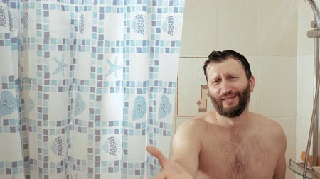 obsession : Bearded man in shower asks for phone, female hand gives man smartphone and he rejoices. Slow motion