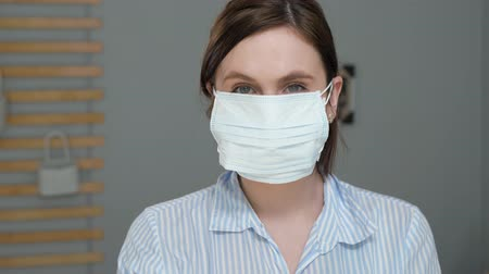 irony : Maximum protection for cold, flu, virus, acute respiratory infections, quarantine, epidemic, irony, sarcasm concept. Attractive girl puts on surgical mask, then one more and one more ...