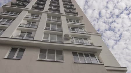 View at new multi storey house with the reflection of the sky in the windows Wideo