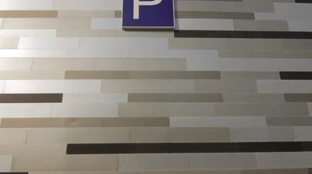 Parking sign on the wall of modern building Wideo
