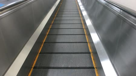 Horizontal escalator or elevator or slide walk in airport on straight view