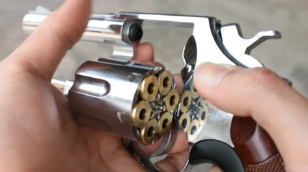 Human is spinning or rotating the revolver or gun or pistol by hand and finger Stock Footage