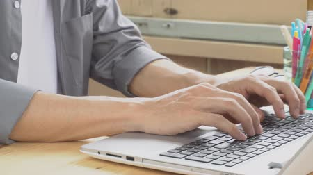 Gray shirt businessman typing laptop keyboard. Small business SME or startup human working or contacting or communicate with customer by internet connection. Hi resolution 4K 3840x2160 footage Stock Footage
