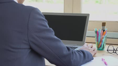Businessman in suit click mouse or working in front of laptop. Small business SME or startup concept. Internet connection and communication style. Hi resolution footage 4K 3840x2160