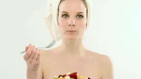eat background : Beautiful young woman in towel eating fruit salad; Full HD Photo JPEG  Stock Footage