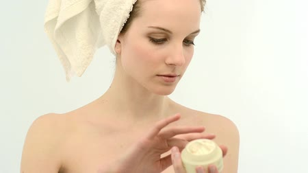 acariciando : Beautiful young woman wrapped in towel applying moisturizer on hands; Full HD Photo JPEG  Stock Footage