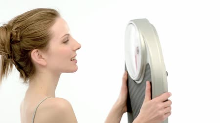 com escamas : Excited woman with a bathroom scale; Full HD Photo JPEG  Stock Footage