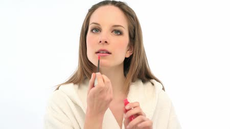 ruj : Young woman applying lipstick Stok Video