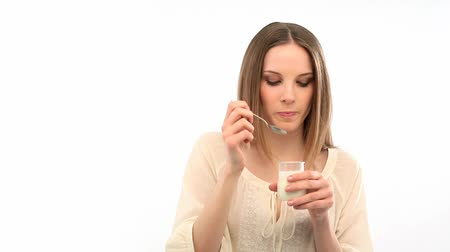 йогурт : Beautiful young woman eating yogurt