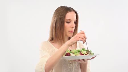 eat background : Beautiful young woman eating salad
