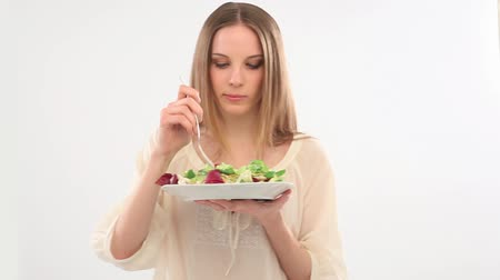 comer : Beautiful young woman eating salad