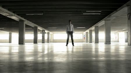 desemprego : Businessman reaching his car in underground parking, Full hd Stock Footage