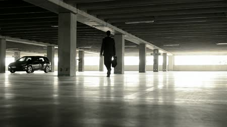 walking man : Businessman reaching his car in underground parking, Full hd Stock Footage