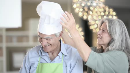 cooks : Happy senior couple in the kitchen, Full HD Stock Footage