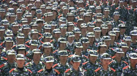 propaganda : Chinese students are lined up during a military practice session. Stock Footage