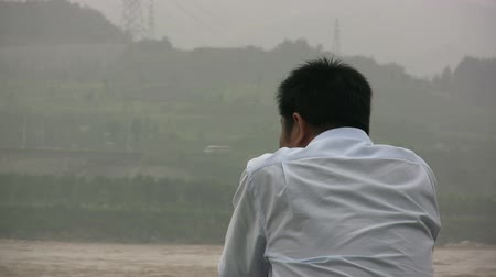 yangtze : A man overlooks a polluted river in China.