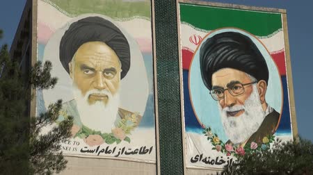 muslim leader : Imam Khamenei and Khomeini on a mural in Iran.