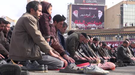 muslim leader : Men take part in a public prayer session as part of Ashura in Iran. Stock Footage