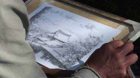 японский рисунок : An artist paints a temple complex in Kyoto.