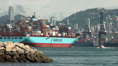 industry : Container ship leaves Hong Kong harbor. Stock Footage