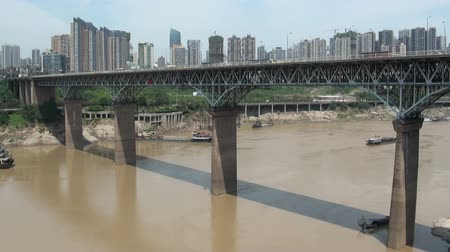 yangtze : A tall bridge spans the Yangtze river in Chongqing. Stock Footage