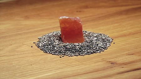 nasiona : Chia seeds and papaya on wooden cutting board