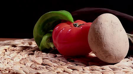 pimentas : Peppers tomato potato eggplant on woven straw and wood Stock Footage