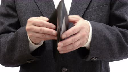 neediness : Businessman showing his absolutely empty wallet - 4k