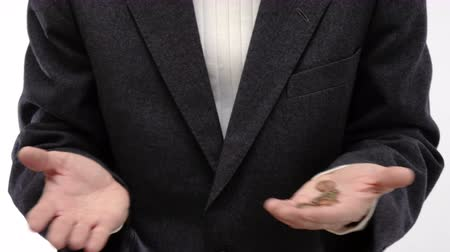 neediness : Businessman counting the coins in the palm of his hand - 4k Stock Footage