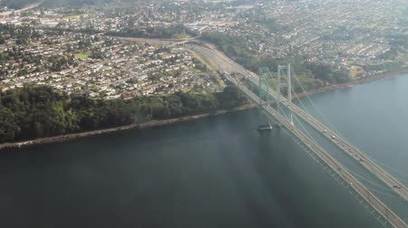 arch bridges : Aerial view crossing over and following the Tacoma Narrows suspension bridge