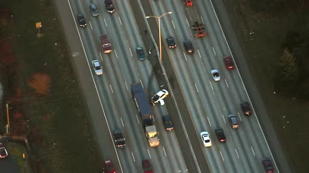 trucks : Circling airplane view of spun out car crash on interstate