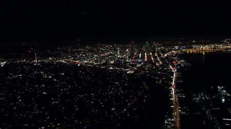Night view of city buildings and streets from low-flying small airplane 影像素材