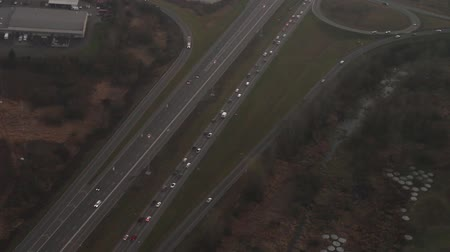 Aerial view flying over heavy traffic on interstate during evening commute