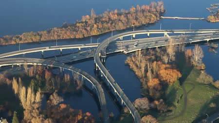 Multiple high definition clips of bridges crossing over a lake