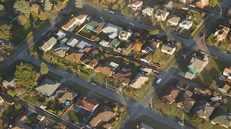 arrabaldes : Low-flying perspective panning across residential street blocks in late afternoon