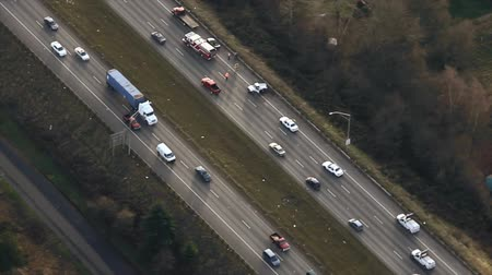Aerial circling view around traffic accident on interstate