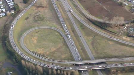 Low-flying panning perspective of commuting traffic on interstate