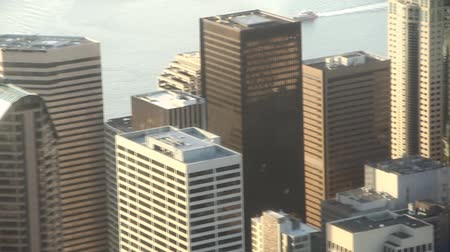 Multiple clips of tall buildings from low-flying aerial view