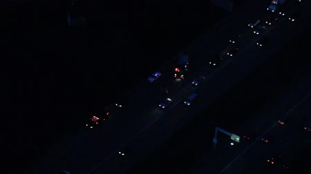 fire officer : Aerial circling perspective of traffic accident and fire truck lights at night Stock Footage