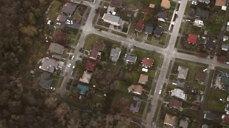vista frontal : Aerial panning view of suburban neighborhood intersections