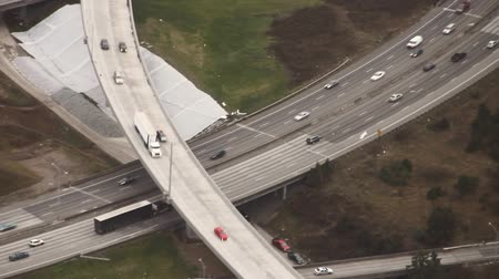 Aerial view following black truck on highway
