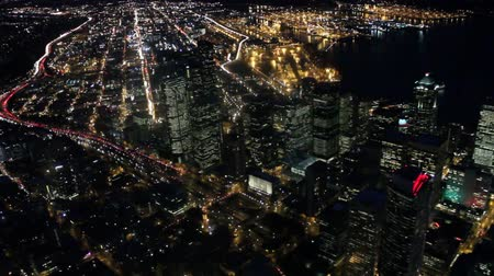 skyscraper : Aerial view looking down on brightly lit Seattle, WA at night Stock Footage