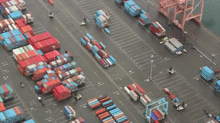 truck crane : Slow pan over freight containers and trucks at a port Stock Footage