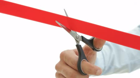 unveil : Red ribbon cutting. HD1080p. White background Stock Footage