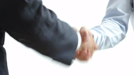kezek : Handshake: two businessmen shaking hands Stock mozgókép