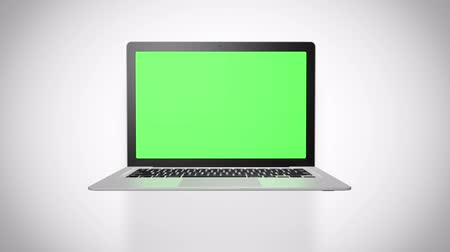 Laptop green screen on white background. Easily customizable computer screen. Seamlessly loopable