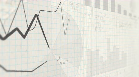 medir : Line charts drawn on paper. Handwritten stock charts, financial graphs and math formulas
