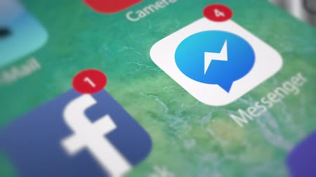 talep : Facebook Messenger. App notifications on smartphone Stok Video